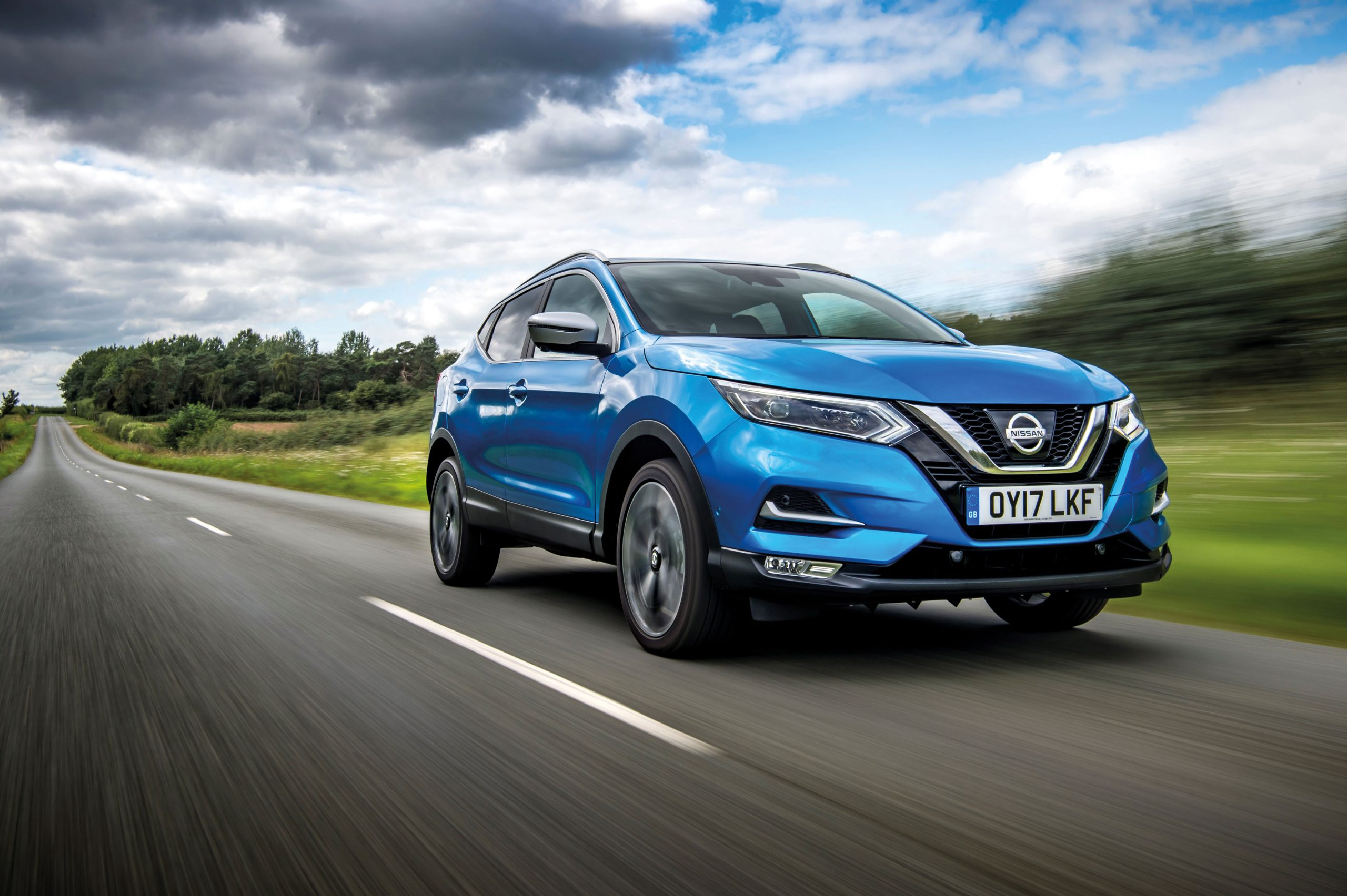 Nissan Qashqai 1, in black driving along a country road