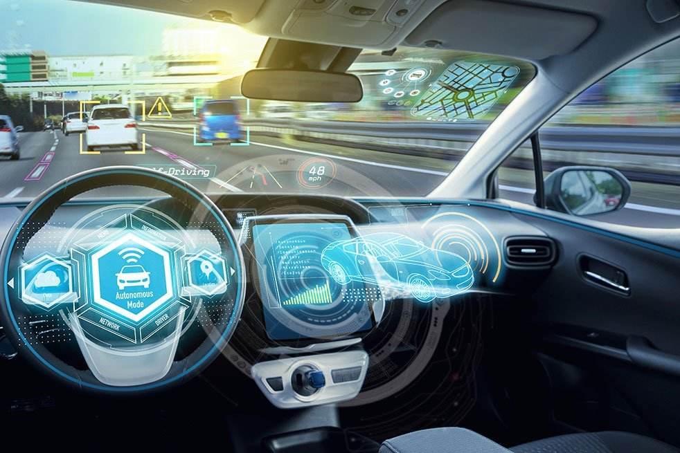 An illustration of car technology. A photo of a car dashboard with an overlay of images showing the technology and what the car can do